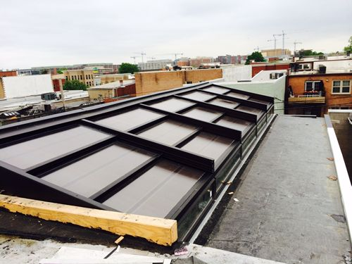 Roll-A-Cover Retractable Suncover Enclosures Covering Washington, D.C. Rooftops