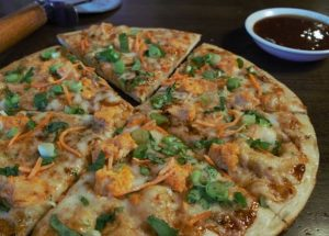 PizzaRev Turns Up the Heat with Thai Chicken Pizza
