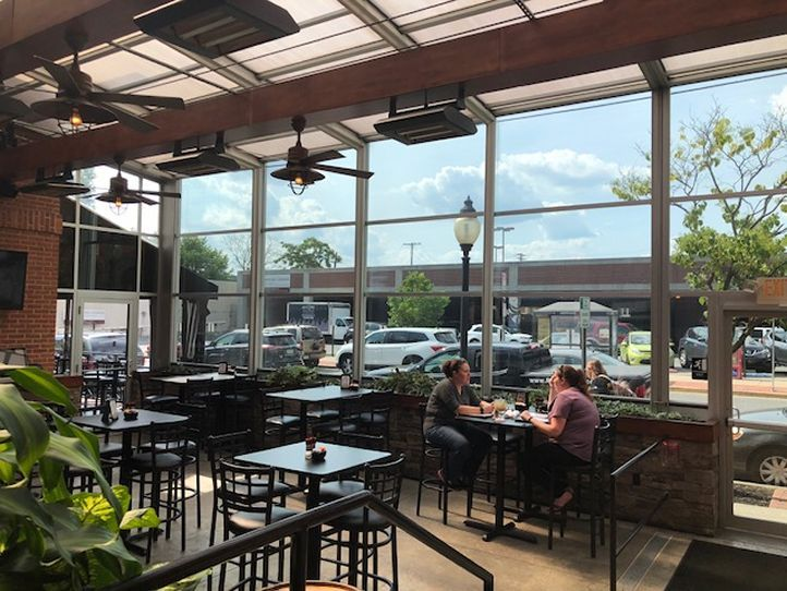 Maximize Your Restaurant's Revenue with a Retractable Patio Enclosure by Roll-A-Cover