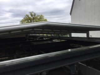 J House Greenwich Features Motorized Roof by Roll-A-Cover