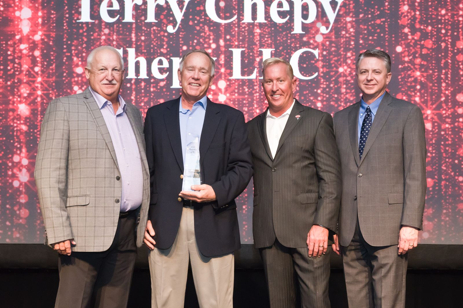 Doug Bostick, Senior VP of Operations & Franchise Development; Terry Chepy, Franchisee of the Year; Carl Howard, Fazoli's CEO; Rodney Lee, Fazoli's CFO.