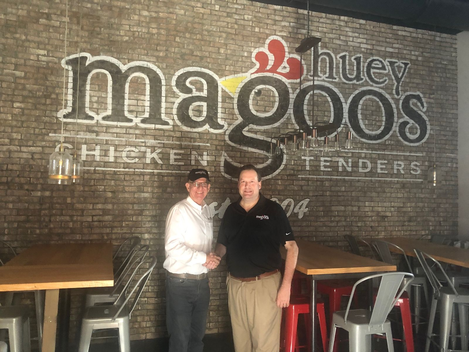 Huey Magoo's President and CEO Andy Howard with Evan Klingman