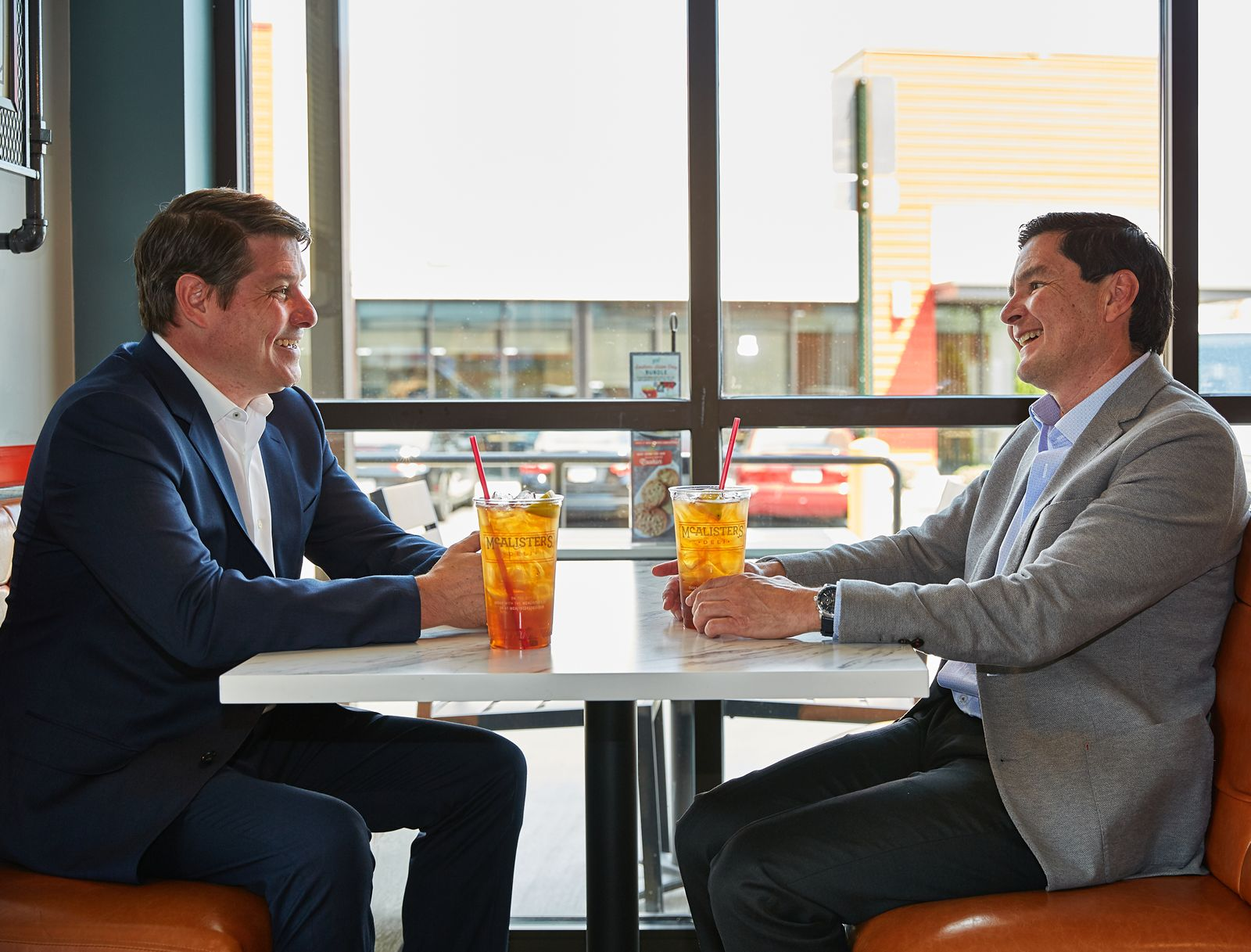Joe Guith, president of McAlister's Deli with Guillermo Perales, founder and CEO of Sun Holdings, Inc.