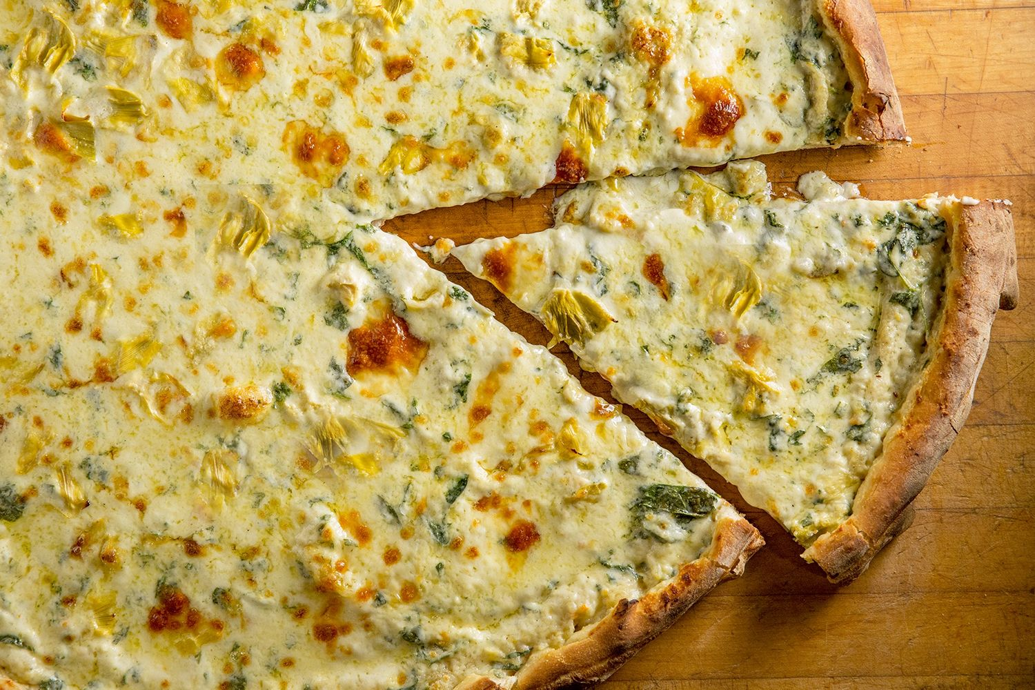 Famed Artichoke Basille's Pizza will open a new location in Jersey City in Spring of 2021.