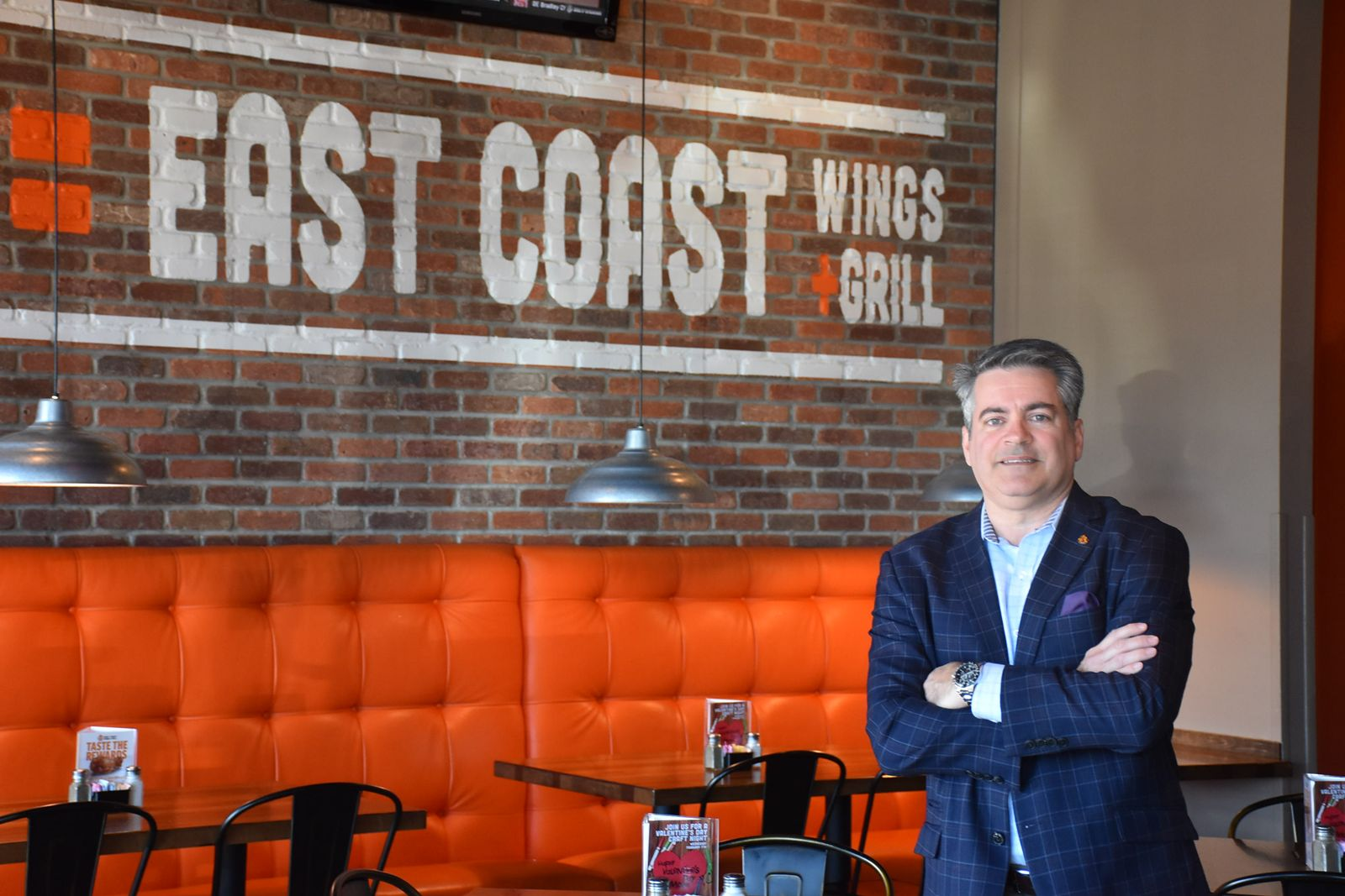Sam Ballas, CEO and president of East Coast Wings + Grill