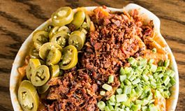 Indulge in National Cheddar Fries Day at Snuffer's