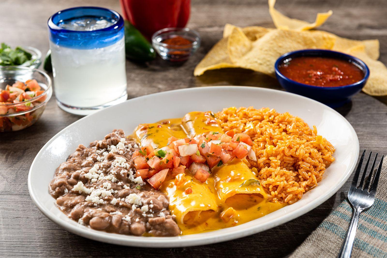 On The Border Cheesy Queso Enchiladas