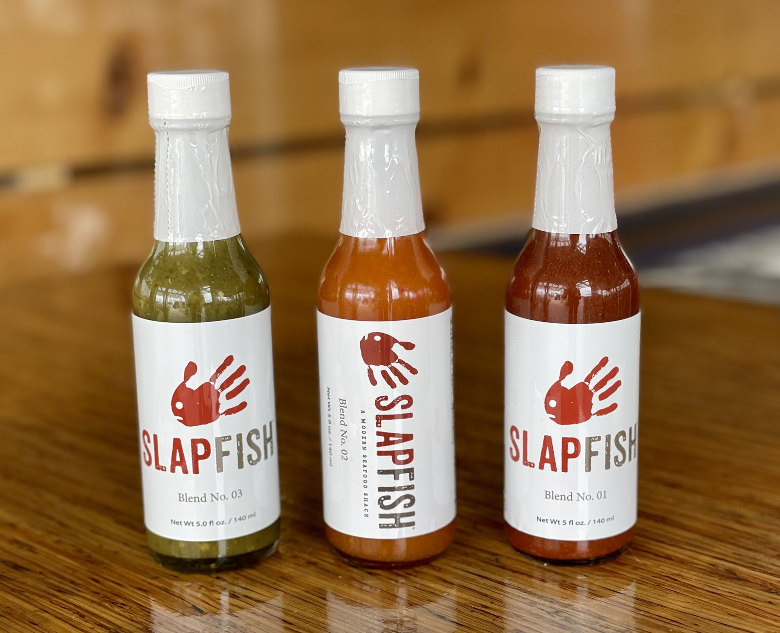 Slapfish, the modern seafood shack with 23 locations across the country, has launched a line of signature hot sauces for retail sale online. Additional sauces and seasonings will be added later this year.